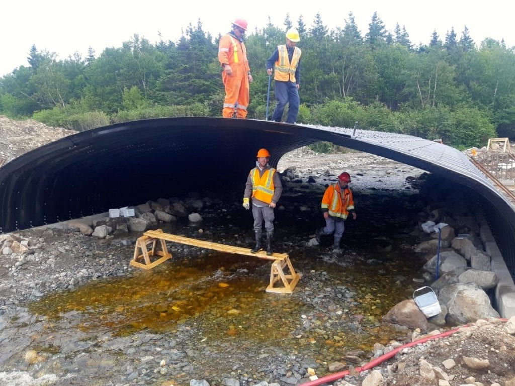 Crew completes box culvert assembly over active streambed